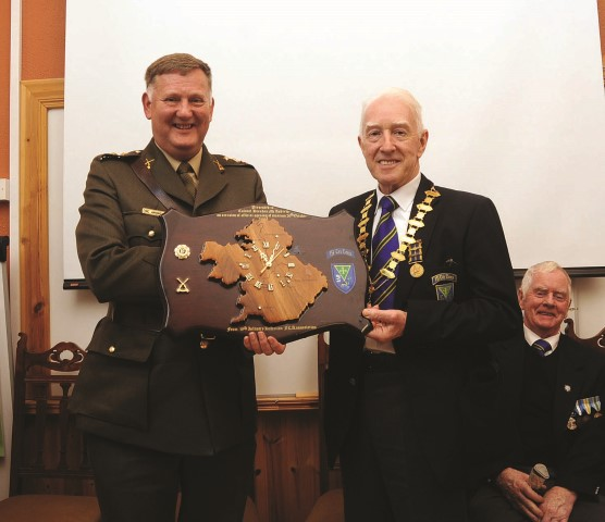 Pictured is Jim Gormley Association President making a presentation to Col. Brendan McAndrew who performed the official opening of the Visitors Centre at the Military Barracks on Sunday evening 26th October 2014.